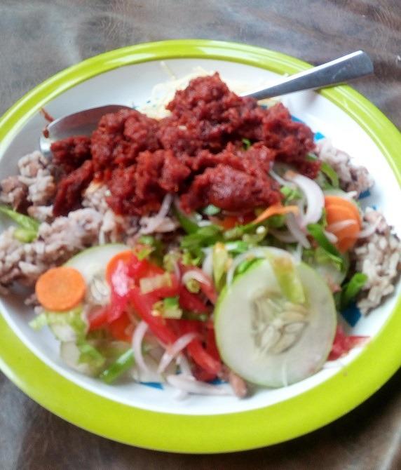 beanrice(waakye) with Ghanaian tomatostew